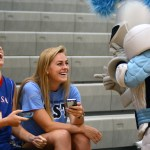 Seniors Mary Booton and Bonnie Longan laugh at the Lancer's dance moves. Photo by Kaitlyn Stratman