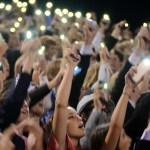 The student section waves their phones with their flashes on later on in the game. Photo by Kaitlyn Stratman