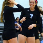 Sophomore Katie Hise laughs with her teammate during their warm up. Photo by Kaitlyn Stratman