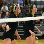 Sophomore Victoria Yedo and Junior Emma Henderson watch their opponent serve the ball. Photo by Kaitlyn Stratman