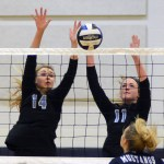 Sophomore Victoria Yedo and Junior Sarah Maddox block their opponents hit, sending the ball back to Blue Valley North. Photo by Kaitlyn Stratman