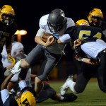 Junior Luke Kaiser is tackled before he can make a touchdown. Photo by Kaitlyn Stratman