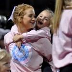 Sophomore Mya Hutcherson smiles after a little Lancer jumps onto her back. Photo by Ellie Thoma