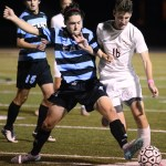 Senior Liam Griffin defends the ball against the other team. Photo by Morgan Browning