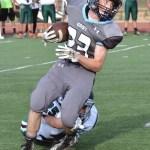 Freshman Garret Boschen runs down the field after receiving the ball. Photo by Abby Blake