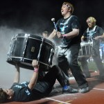 Senior Josh Clayton plays the drum after putting baby powder on it, causing the crowd to go wild. Photo by Abby Blake