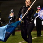 Senior Lauren Blackburn twirls a flag in her routine. Photo by Diana Percy