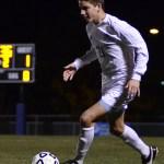 Junior Oliver Bihuniak dribbles down the field. Photo by Kaitlyn Stratman