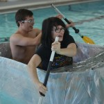 Seniors Chloe Neighbor and Logan Bennion paddle across the pool to beat the previous team's time. Photo by Abby Blake