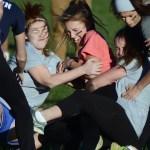 The senior girls tackle junior Gretchen Crum. Photo by Kaitlyn Stratman