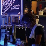 The bartender works hard to serve everyone throughout the night. Photo By Kaitlyn Stratman