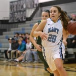 Sophomore Jordan Yowell runs past her defender for a layup. Photo by Haley Bell