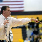 Head coach Shawn Hair yells at his players to set up a play.  Photo by Tess Iler