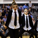 Senior Lauren Blackburn and the varsity drill team perform their secret service-themed hip-hop dance. Photo by Diana Percy