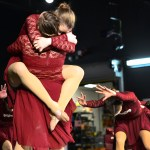 Senior Emily Meiring embraces senior Emma Olander after jumping into her arms at the end of the lyrical dance. Photo by Diana Percy