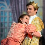 Junior Kylie Ledford, playing a townsperson, hugs Senior Charlie Jenson, playing Prince Charming, during the Ball scene. Photo by Morgan Browning