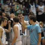 The Lancers huddle and put their fists in for a cheer to pump up the team. Photo by Audrey Kesler