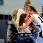 Junior Quincy Bahr hugs Senior Claire Gibbs during Senior Night.  Photo by Tess Iler