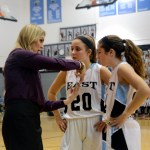 Freshmen Jordan Yowell and Madison Mustoe talk with Head Coach Lauren Lawrence during a free throw.  Photo by Tess Iler