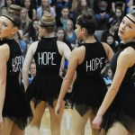 Junior Gretchen Crum and sophomore Emma Renwick perform during the Varsity Lancer Dancer routine. Photo by Haley Bell