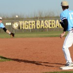 Junior Trevor Thompson throws ball to first base Photo by Carson Holtgraves