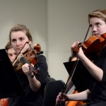 Seniors Kate Hales and Caroline Olson play viola during the symphonic orchestra's performance.  Photo by Tess Iler