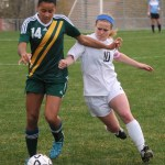 Senior Adalaide Kline is blocked out by a Shawnee Mission South player. Photo by Haley Bell