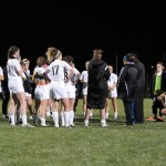 The Lancers meet after their loss to discuss the game. Photo by Haley Bell