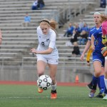 Junior Lilly Flint sprints to regain possession of the ball before the Olathe South goalie has a chance to pick it up. Photo by Haley Bell