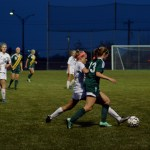 Senior Elizabeth Shook gets a foot on the ball in the struggle for possession. Photo by Kaleigh Koc