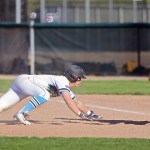 Sophomore Jonah Watt dives for  second base before the second baseman can get him out. Photo by Kaitlyn Stratman