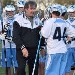 Head Coach Will Garrett talks to the players during a break in the game. Photo by Abby Blake