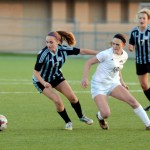 Junior Libby Legard breaks away from her defender toward the ball. Photo by Ellie Thoma