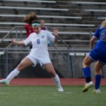 Freshman Emily Cooper stops the pass that was made by her teammate. Photo by Kaitlyn Stratman