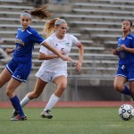 Senior Elisabeth Shook sprints to get the ball before the other team's defenders. Photo by Morgan Browning