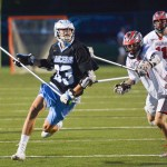 Senior Mark Ward clears the ball down the field and passes to an attackman. Photo by Ellie Mitchell