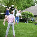 Graduates play volleyball at Hayes Hendricks, Luke Ehly and George Colby's graduation party. Photo by Porter Carroll