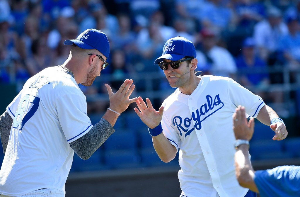 Paul Rudd, right, is congratulated by the Kansas City Chiefs' Travis Kelce after scoring during the Big Slick celebrity softball game on Friday, June 19, 2015, at Kauffman Stadium in Kansas City, Mo. (John Sleezer/Kansas City Star/TNS)