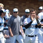 From the on-deck circle, senior Henry Churchill applauds the baserunner. Photo by Joseph Cline