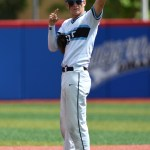 Junior Trevor Thompson salutes the crowd after a play at second base. Photo by Joseph Cline