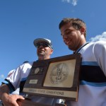 Senior Henry Churchill and coach Ryherd  take in the glory of their newly aclaimed championship plaque. Photo by Joseph Cline