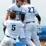 Juniors Jake Randa and Henry Miller celebrate after Randa's play in the outfield.  Photo by Spencer Carey