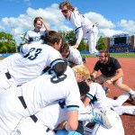 Junior Jake Randa leaps into the dog pile near first base. Photo by Spencer Carey