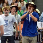 Seniors Jack Griswold, Jackson Ceule and Luke Ramey teach the 'SME-Let's Go' chant to students. Photo by Audrey Kesler