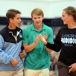 Seniors Oliver Bihniak, Stanley Morantz and Clayton Phillips walk off the floor after announcing details about upcoming soccer games. Photo by Audrey Kesler