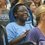 """Freshman Aggie Williams smiles while learning this season's cheers. She says, """"Now that I'm here I am proud to say that I am a Lancer"""" Photo by Caroline Mills"""
