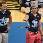 Senior football captains Eli McDonald and Carl Young give a speech about the upcoming season and encourage students to go to the game. Young drops the mic' after his pep talk. Photo by Diana Percy