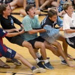 Varsity soccer players (from left to right) Stanley Morantz, Grayson Rapp, Clayton Phillips, Taylor Stover, Oliver Bihuniak and Luke Ramey  play tug-of-war with members of the football team. Soccer won the competition 2-1. Photo by Diana Percy