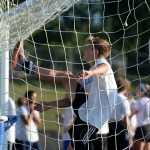 Messing around with the ball, Junior Sam Thompson kicks it to the top of the net. Photo by Kaitlyn Stratman