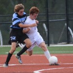 Junior Tommy Nelson shields the ball from freshman Peter Kohring. Photo by Carson Holtgraves